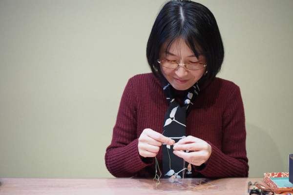This is Mrs Yukiko Onishi.  A magically beautiful Kaga thimble is being born from her fingers.