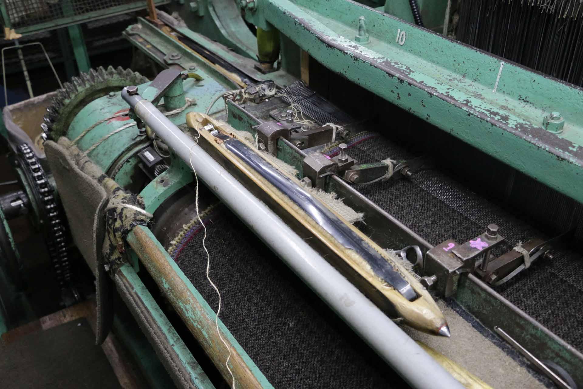カーペットの織機。堀田カーペットは18世紀イギリスの産業革命の頃に世界で初めて機械化されたカーペット織機「ウィルトン織機」を代々使っている