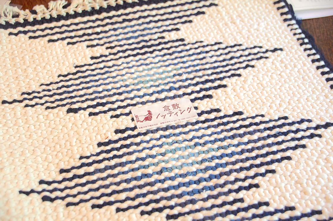 倉敷本染手織研究所や卒業生の手で織られた証としてつけられているブランドラベル